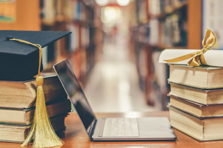 image of library books, laptop, graduation cap
